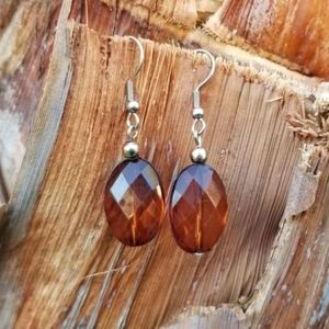 Beautiful earrings with amber colored beads